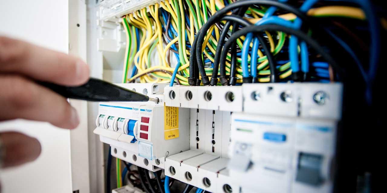 electrician working on power board
