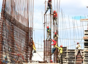 constructions workers adding steel framing