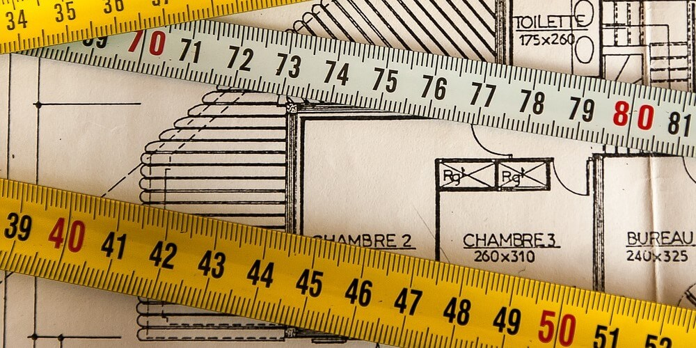 measuring tape and blueprint