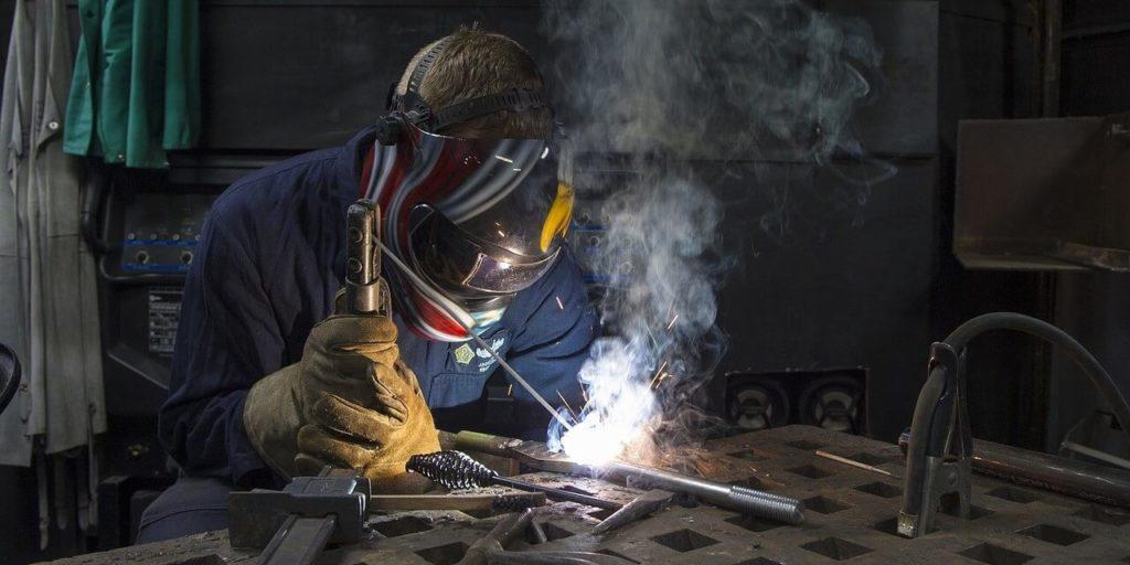 worker welding a pipe